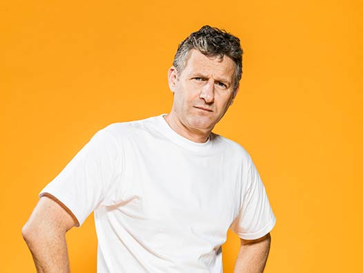 Last Leg presenter Adam Hills looks at the camera