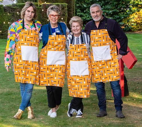 The Bake Off judges and hosts standing outside the tent