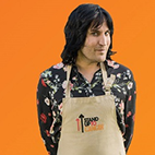Noel Fielding wearing a Great Stand Up To Cancer Bake Off apron