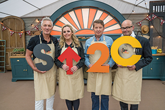 Celebrities from the Great Stand Up To Cancer Bake Off holding an SU2C sign