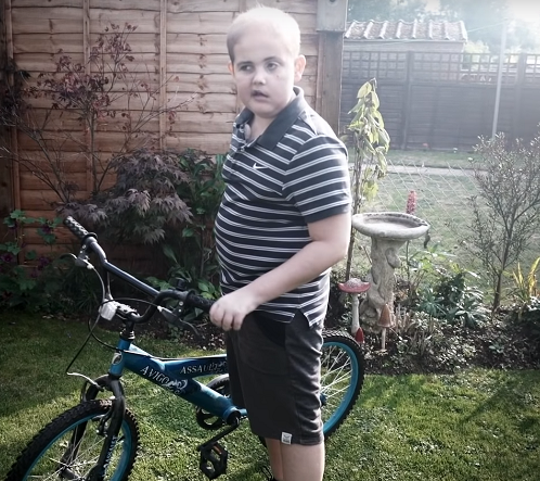 Charlie on his bike in his garden
