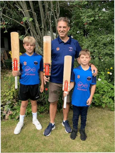 Clint and his sons with a cricket back