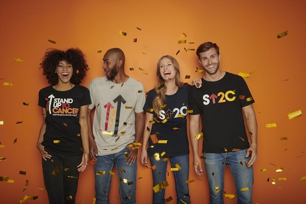 A group of people in SU2C t-shirts