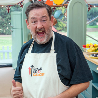 Johnny Vegas with thumbs up in Bake Off tent