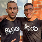 Courtney Wildin and his friend Cameron stood with their arms around each other wearing Blood Brothers t-shirts