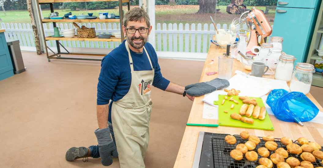 Louis Theroux on the floor in the Bake Off tent