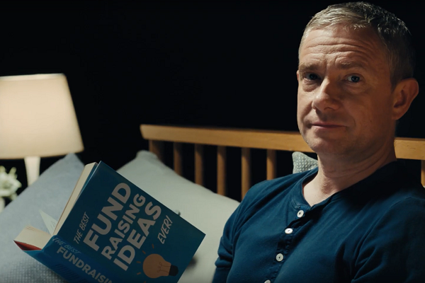 Martin Freeman reading a fundraising ideas book