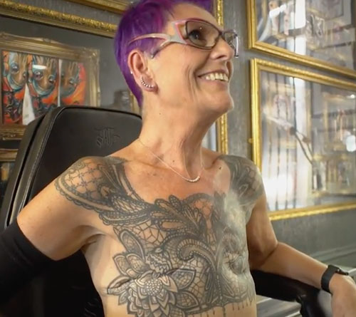 Sue displaying her mastectomy tattoo