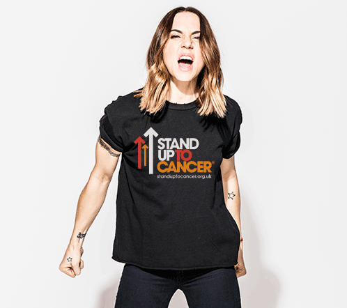 Mel C shouting and wearing a Stand Up To Cancer t-shirt