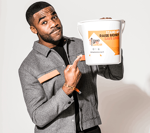 Ore Oduba with a collection bucket for Stand Up To Cancer