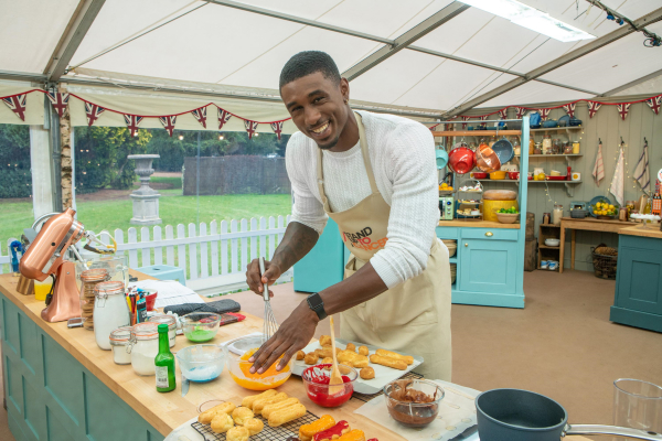 Ovie Soko baking on the Great Stand Up To Cancer Bake Off