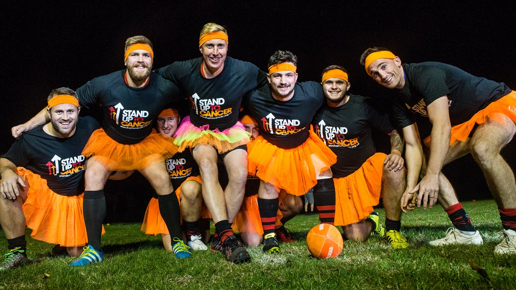 Chelmsford Rugby Team wearing orange tutus.