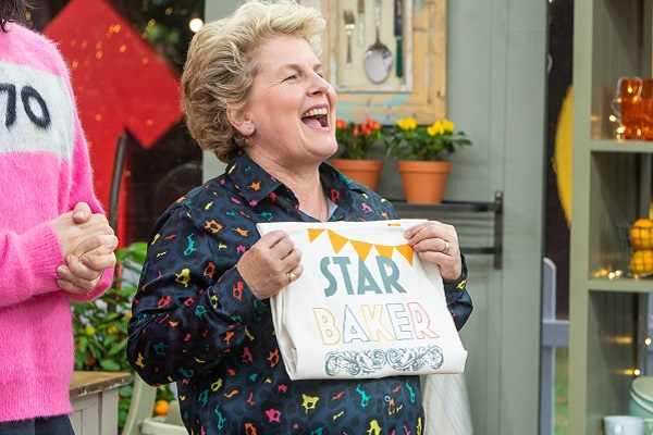 Bake Off host Sandi Toksvig holding the Star Baker apron