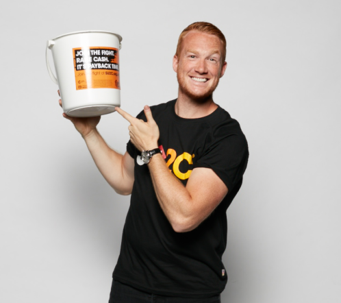 Greg Rutherford holding donation bucket.