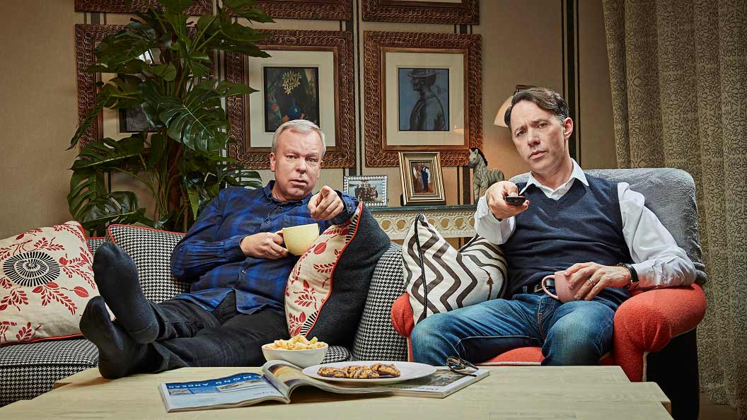 Steve Pemberton and Reece Shearsmith point towards the screen while watching Celebrity Gogglebox on for Stand Up To Cancer