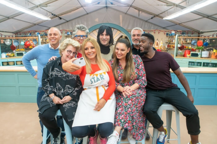 Star Baker Carol Vorderman taking a selfie with the other Bake Off celebs, hosts and judges