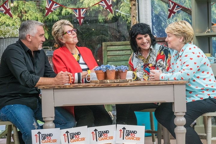Great British Bake Off Judges Smiling Around Table