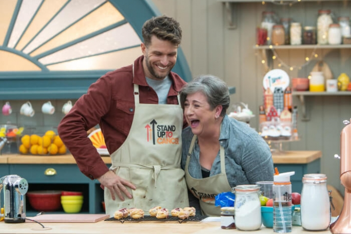 Caroline Quentin and Joel Dommett laughing in the Bake Off tent
