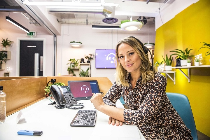 Kimberly Walsh answering phone in call centre.