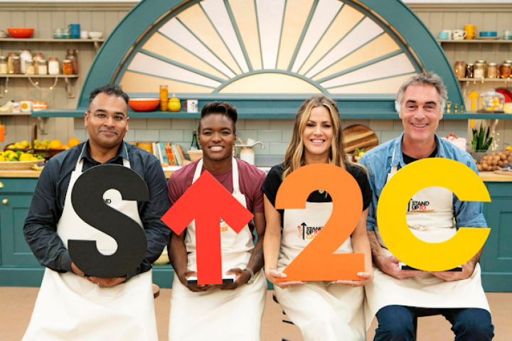 Greg Wise, Nicola Adams, Krishnan Guru Murthy and Caroline Flack holding the SU2C sign and looking at the camera