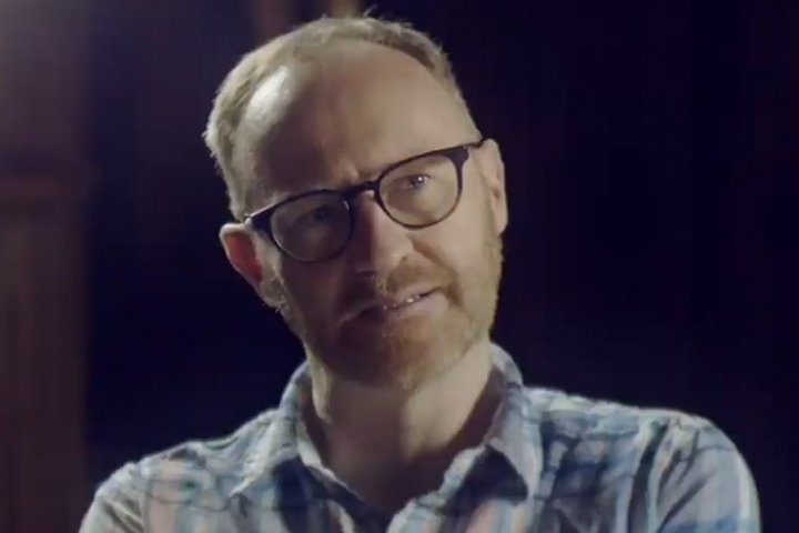 Makr Gatiss looking off camera as he talks about losing his mother and sister to cancer
