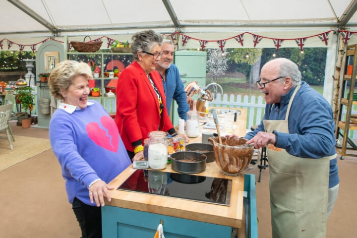 Richard Dreyfus and the Bake Off hosts and judges laughing in the Bake Off tent