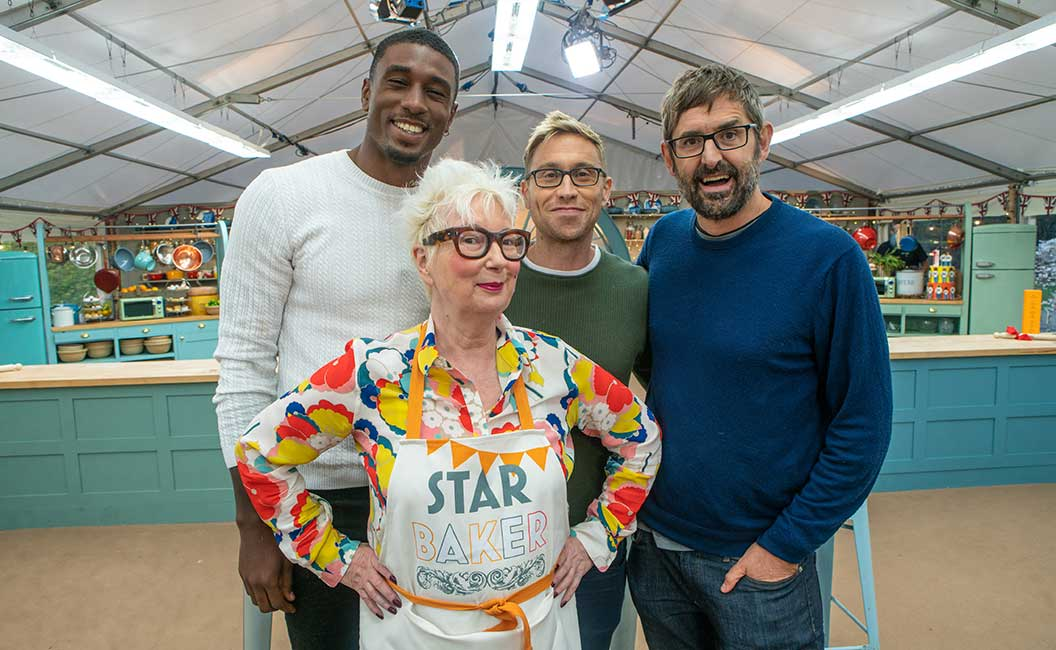 Jenny Eclair in her Star Baker apron with the Bake Off celebrities