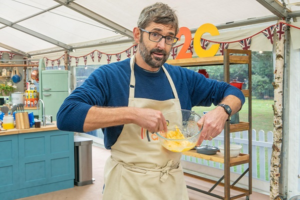 Louis Theroux whisking eggs in the Bake Off tent