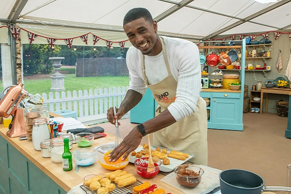 Ovie Soko whisking eggs in the Bake Off tent