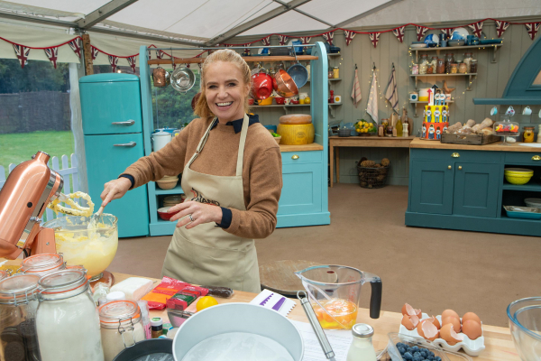 Patsy Palmer using a mixer in the Bake Off tent