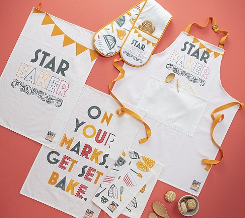 The Star Baker merchandise oven gloves, apron and tea towels