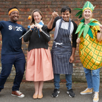 Four people dressed up in different outfits