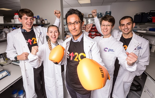 Stand Up To Cancer Scientists with boxing gloves