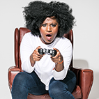 Susan Wokoma with a console gaming