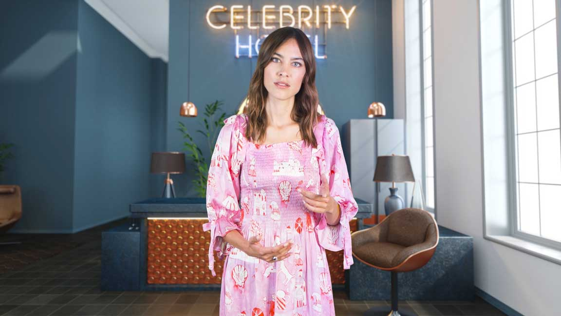 Alexa Chung talking in Stand Up To Cancer Quiz in a hotel lobby in a pink dress