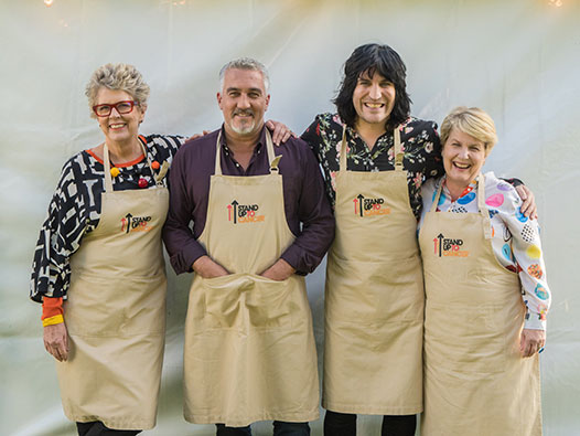 Noel Fielding, Paul Hollywood, Prue Leith and Sandi Toksvig standing outside the Bake Off tent